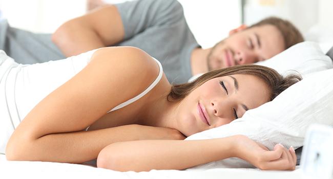 Couple asleep on mattress