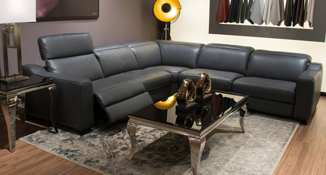 Leather sectional with recliner