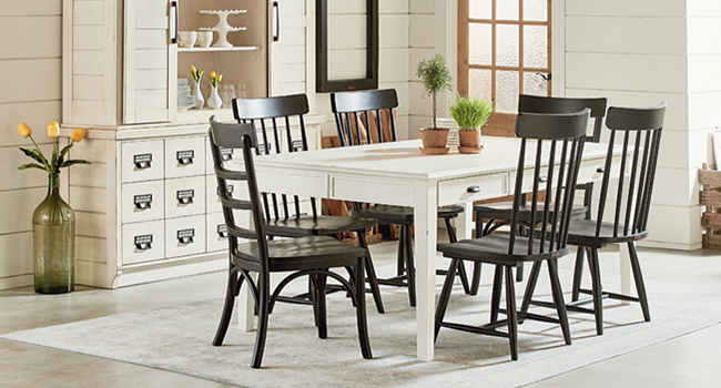 White dining room table with brown accent chairs, and white dining room area rug