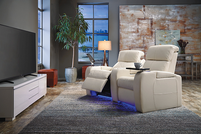 Living room with reclining chairs and entertainment center