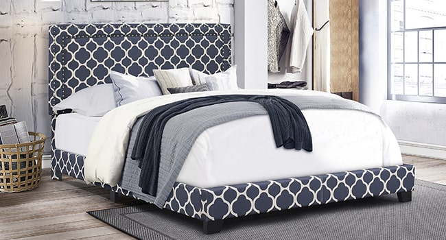 Bed with blue patterned headboard and footboard