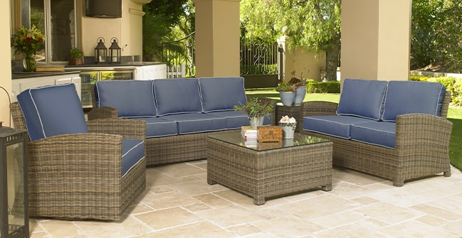 Outdoor patio furniture set with sofa, loveseat, chair and occasional table