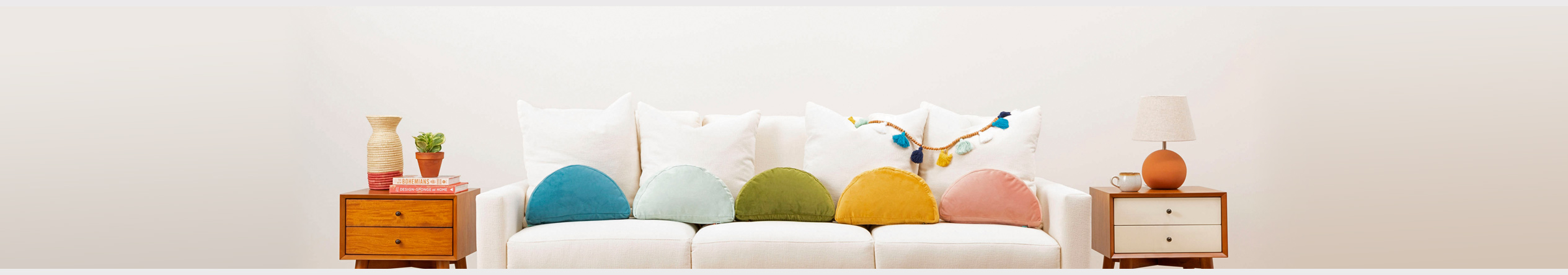 Jonathan Louis Design Lab Sofa with unique & colorful half-moon pillows