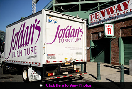 Jordan's Furniture delivers a truck filled with youth baseball equipment to Fenway Park!