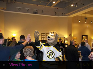 Providence Bruins team mascot Samboni gets a high 5 from an excited fan