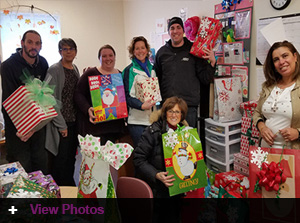 Jordan's Furniture employees deliver to local Head Start Programs Over 550 gifts donated by the J-Team for the 2017 holiday season
